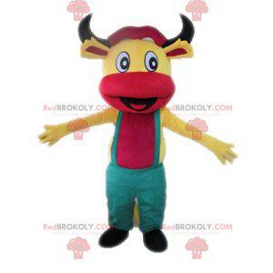 Maskot žluté a růžové krávy s kombinézou - Redbrokoly.com
