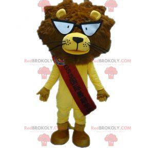 Žlutý a hnědý lev maskot s brýlemi - Redbrokoly.com