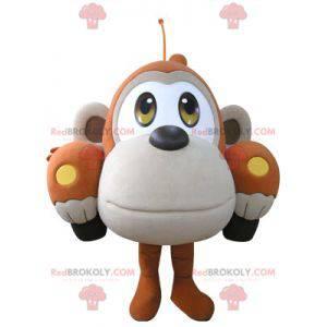 Car mascot shaped like an orange and beige monkey -