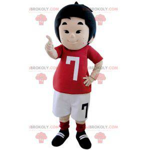 Malý chlapec maskot oblečený v oblečení fotbalisty -
