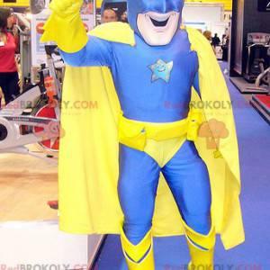 Mascote do super-herói em combinação de amarelo e azul -