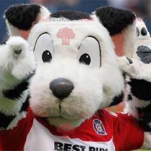 White and black spotted dog mascot in sportswear -