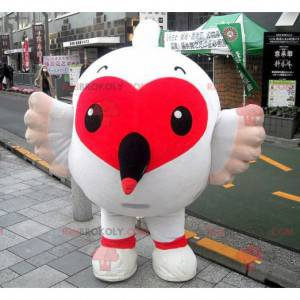 Maskottchen großer weißer Vogel mit einem hübschen roten Herzen