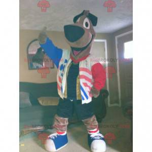 Large brown dog mascot with a red white blue jacket -