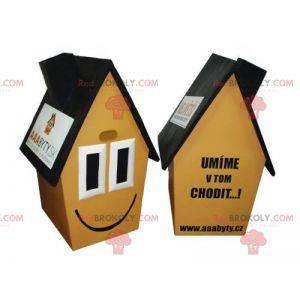 Bardzo uśmiechnięta żółta brązowo-czarna maskotka domu -