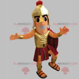 Gladiator-Maskottchen im goldenen und roten Outfit -