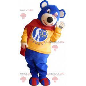 Maskottchen kleiner blauer Bär, der einen roten Schal trägt -