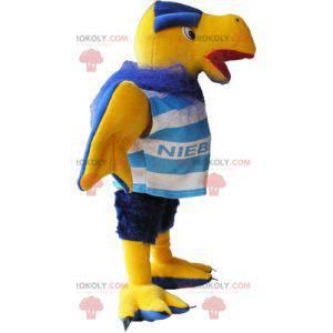 Gelbes und blaues Geiermaskottchen in der Sportbekleidung -