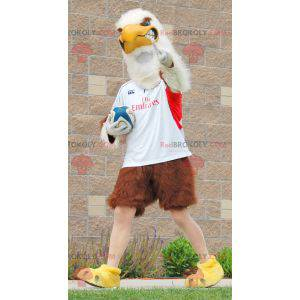Obří hnědý a bílý orel maskot ve sportovním oblečení -