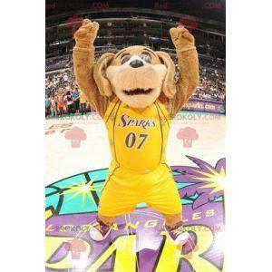 Hnědý pes maskot v žluté sportovní oblečení - Redbrokoly.com