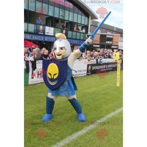 Mascotte del cavaliere con un casco e uno scudo - Redbrokoly.com
