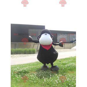 Czarno-biała małpa maskotka z czerwonym szalikiem -