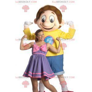 Usmívající se maskot chlapec školák oblečený v modré a žluté