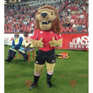 Roaring brown lion mascot in black and red outfit -