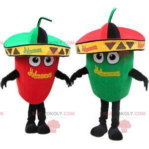 2 Maskottchen mit riesigen grünen und roten Paprikaschoten. Ein