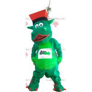 Grünes Dinosauriermaskottchen mit einem Hut - Redbrokoly.com