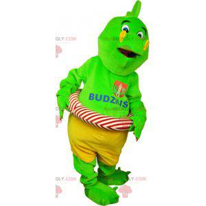 Maskot zeleného dinosaura v šortkách s bójí - Redbrokoly.com
