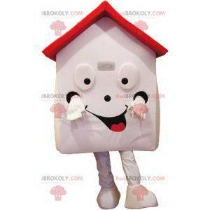 Sehr lächelndes weißes und rotes Hausmaskottchen -