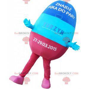 Mascotte de pilule bleue et rose. Mascotte de médicament -