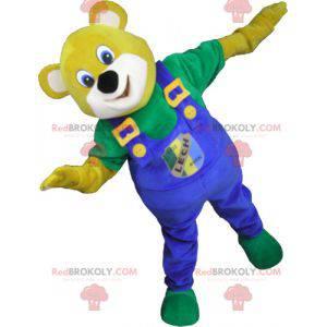 Maskot žlutý medvěd s modrými kombinézami - Redbrokoly.com