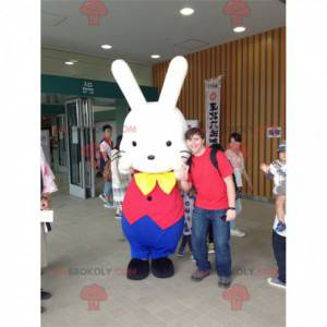 White rabbit mascot in red and blue outfit - Redbrokoly.com