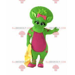 Riesiges und warmes grünes und rosa Dinosauriermaskottchen -