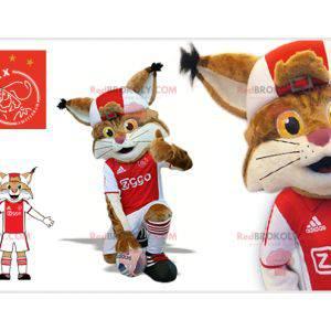 Hnědý a bílý rys maskot v oblečení fotbalisty - Redbrokoly.com