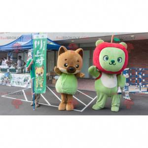 2 maskoti, hnědá liška a zelený medvěd s jablkem -