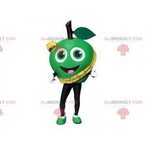 Sehr lächelndes grünes Apfelmaskottchen. Riesiger grüner Apfel