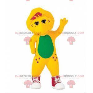 Žlutý a zelený dinosaurus maskot s teniskami - Redbrokoly.com