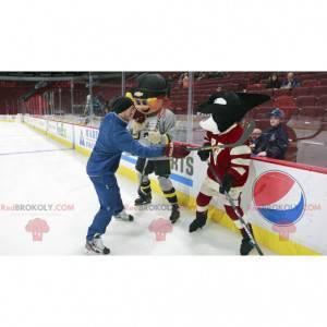 Maskot blonďák a černá kosatka v hokejové výstroji -