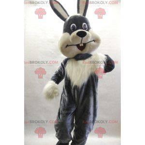 Haariges und süßes graues und weißes Kaninchenmaskottchen -
