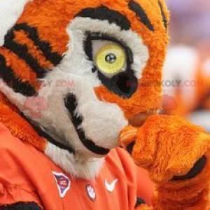 Black and white orange tiger mascot in sportswear -