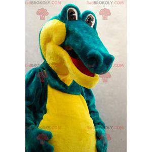 Weiches und lustiges grünes und gelbes Krokodilmaskottchen -