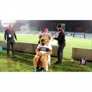 Hnědý pes maskot ve sportovním oblečení - Redbrokoly.com