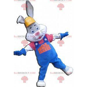 Graues und weißes Kaninchenmaskottchen mit Overall und