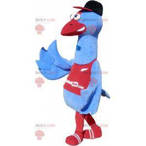 Maskotka niebieski ptak w odzieży sportowej. Maskotka bocian -