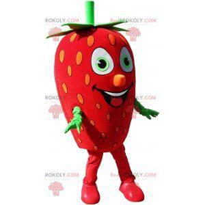 Obří jahodový maskot. Maskot červené a zelené ovoce -