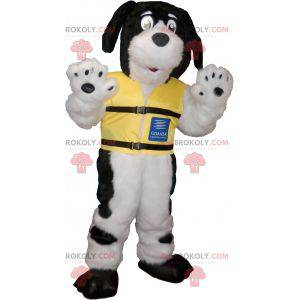 Black and white hairy dog mascot with a yellow vest -