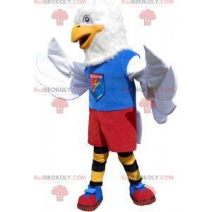 Weißes Adler-Maskottchen in der bunten Sportbekleidung -
