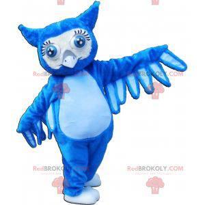Riesiges Maskottchen der blauen Eule mit großen blauen Augen -