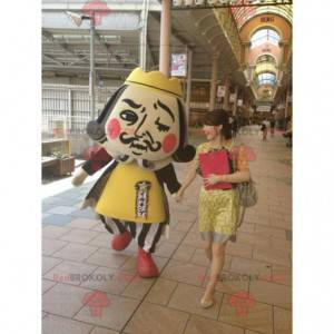Imperial man king mascot in yellow and black outfit -