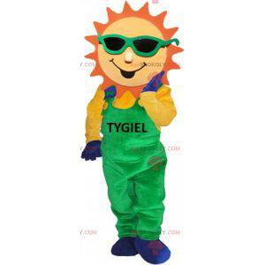 Sluneční maskot oblečený v zelených kombinézách - Redbrokoly.com