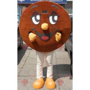 Mascota de galleta marrón y sonriente redonda gigante -
