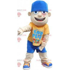 Mladý dospívající maskot maskot v modré a žluté oblečení -