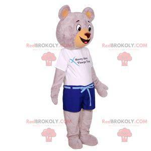 Großes graues Teddybärmaskottchen gekleidet in Sommerkleidung -