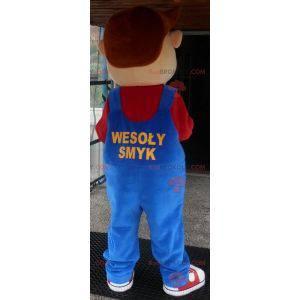 Ung smilende gutt maskot kledd i kjeledress - Redbrokoly.com
