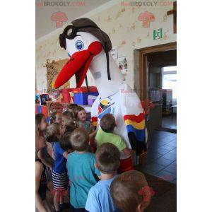 Hvit stork maskot med fargerike vinger - Redbrokoly.com