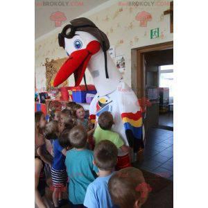 Maskot bílý čáp s barevnými křídly - Redbrokoly.com