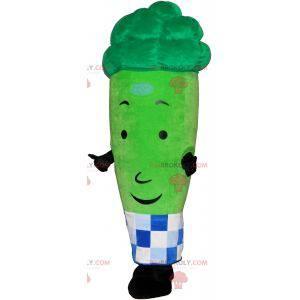 Obří zelený chřest maskot obklopený kostkovaným papírem -